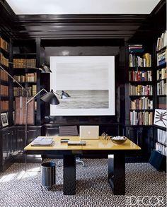 office - high gloss paint on full length bookshelves