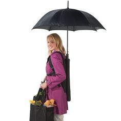 The Backpack Umbrella - Hammacher Schlemmer. Worn on the back to protect form sun or rain while keeping your hands free.
