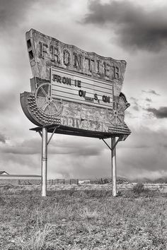 An abandoned drive-in theater sign reminds us of a day where couples and families used to experience the magic of Hollywood all from their car. This weathered sign presents a harsh and poignant metaphor for drive-ins and the cinema in general. - Rio Grande County, CO