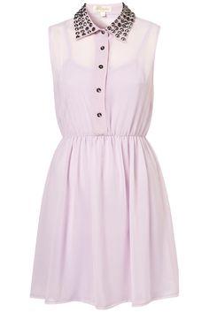 Sleeveless shirt dress with lined skirt and studded collar.