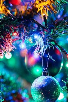 Stock photo of Details on a Christmas tree by beatrixboros Christmas Mood, Blue Christmas, Christmas Pictures, Beautiful Christmas, Christmas Bulbs, Christmas Decorations, Christmas Tree Wallpaper Iphone, Holiday Wallpaper, Christmas Lights Background