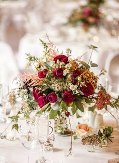 Beautiful country wedding flowers incorporating country foliage and red roses…
