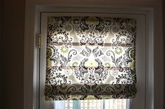 roman blind... need to make this for the front door. Maybe one for back door too?