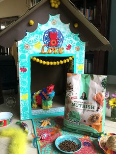 A DIY indoor cat playhouse with a nice dish of Rachael Ray Nutrish!