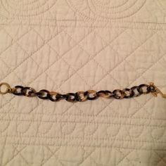"Tortoise shell, acrylic link bracelet Acrylic, link bracelet in tortoise shell colors. Gold toggle closure.  Measures 8"" in length.  Good condition. Jewelry Bracelets"
