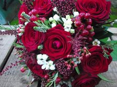 Stunning red roses for a Xmas hand tied at Coombe lodge Bijouxfloral.co.uk