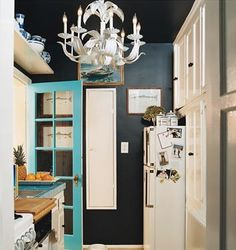 Love this: Navy walls with that turquoise door!