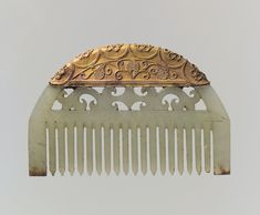 Comb made from carved jade and gold decorated with granulation. China, Eastern Han dynasty. 25–220 AD. [3784x3122] : ArtefactPorn
