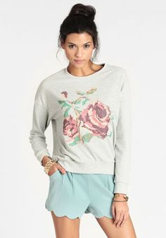 Coming Up Roses Pullover from ThreadSence - A heather grey sweatshirt with a cross stitch floral design. I can't quite tell if it's actual stitch work or a screen print but I like the concept either way.