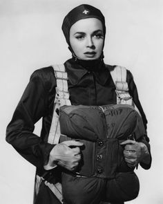"""Parachute Nurse [1942]  This is a 1942 photo of a nurse in World War 2. Apparently, they had """"parachute nurses"""" during that war. HMMMM. If this job still exists right now, I'd be the first to sign up!!!!"""