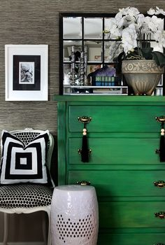 Hollywood regency style green sideboard with tassels, white ceramic drum stool & seagrass cloth walls
