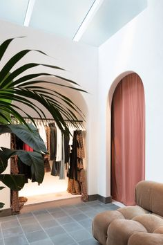 Wide archways, vintage furniture and tropical plants feature in the first bricks-and-mortar shop for women's fashion brand ALC, designed by American architecture firm Janson Goldstein.