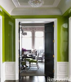 The entry's contrasting dark floor makes the white woodwork appear even brighter.