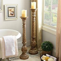 add floor pillar candle holders to your living room or to your bathroom for a stylish mood setting piece of decor beautiful living room pillar