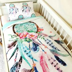 http://www.poppycotton.co.nz/product/dream-catcher-cot-quilt-pink-and-aqua