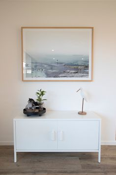 Clean modern lines and a simple colour palette make this corner of the living room feel light and contemporary. The large scale photographic art is set off nicely with accessories that reflect nature. #livingroom #modernliving #photoart #natural #minimalisticstyle #generationhomesnz #totaraplan 4 Bedroom House Plans, Simple Colors, House Architecture, Family Rooms, Contemporary, Modern, Scale, Palette, Minimalist