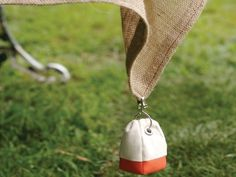 Boat Buoy Tablecloth Weights from Katie Brown on OpenSky  * I also love the jute tablecloth, too!  They would be perfect for the Summer Solstice Dinner I'm planning!