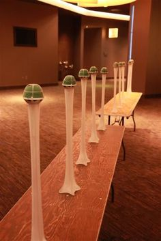 Genuis! Those green foam balls with artificial flowers as centerpieces
