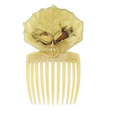 AN ART NOUVEAU HORN AND GOLD CHESTNUT HAIR COMB, BY RENE LALIQUE