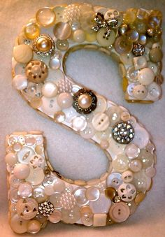 bedazzled letter. letter can be bought at an art store. maybe good for door decor or a wall collage