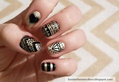 "gold and black graphic ""tribal"" manicure"