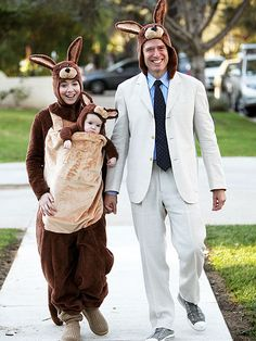The family that dresses together, hops together! The Hannigan-Denisofs step out in cuddly kangaroo costumes for Satyana's first Hallowee