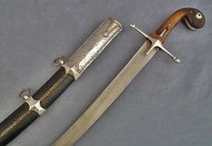 Ottoman kilij, you can see the typical Ottoman metal spiral stitching on the scabbard.