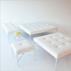 "custom-made original by taylor creative  white coated metal with white vinyl upholstery.  new material is resistant to pen and denim stains.    cube: 22"" square x 18"" H (16 pieces available)    bench: 22""D x 72""W x 18"" H (14 pieces available)    ottoman: 48"" square x 18"" H (8 pieces available)  large ottoman: 60"" square x 18"" H (8 pieces available)"
