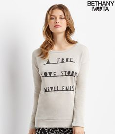 """OMG, my Love Story Oversized Sweatshirt is the cutest top to wear while curling up with a good book! It's soft, snuggly and pairs perfectly with yoga pants or leggings; to top it off, the front is decorated with super-sweet text. I literally can't get enough of it! ILY, xoxo Beth<br><br>Relaxed fit. Approx. length: 27.5""""<br>Style: 4745. Imported.<br><br>55% cotton, 45% polyester.<br>Machine wash/dry.<br><br>Model height: 5'10""""; Size: Small."""