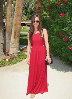 Coachella Festival Style: A maxed-out look comprised of a red cutout dress and strappy sandals.
