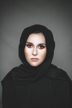 The stunning Dina Tokio for Issue 12 of Blogosphere magazine wearing a simple black hijab and bold red eye makeup.  https://www.blogospheremagazine.com/  Photography by Alexandra Cameron
