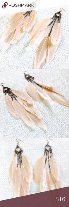 Statement feather earrings These are show stopping fabulous....  Here I took these amazingly nude Duck Feathers and enhanced them by adding Silver accents  The bronze filigree is stunning paired with the feathers   Silver earwire sent with enclosure for safety   All metals are LEAD free  Length- 8 inches  ****** This item can be reproduced in other metals and colors******  *** Please contact me with any questions @ www.luxandcher.etsy.com  ** Thank you for viewing LUX & CHER Jewelry Earrings