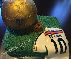 Golden Soccer cake/ Ballon D'or trophy cake/ Real Madrid jersey. Fifa, Soccer Party Favors, Soccer Cake, Ballon D'or, Real Madrid, Football Helmets, Cake Decorating, Parties, Cakes