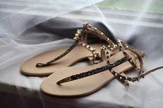 Embellished flat sandals.