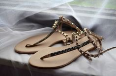 Embellished flat sandals.