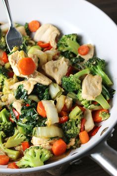 Delicious Stir-fry with chicken, broccoli, Napa cabbage, Bok Choy, and carrots.