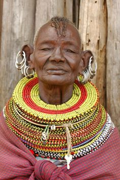 """**Africa   Turkana woman. Maralal, Kenya  I love the way the metal rings pull the ear away from the head. It gives that, """"I can fly"""" look of complete confidence"""