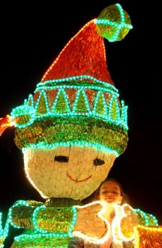 A girl poses for a picture in a street illuminated with Christmas lights in MEDELLIN, Colombia