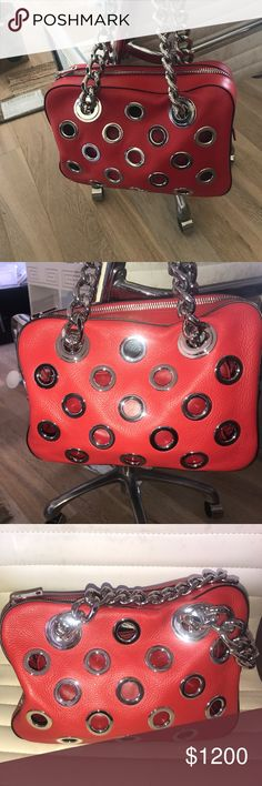 Prada leather grommet bag with  chain in red. Prada calf leather. Silver metal hardware and handles. BRAND NEW!!!! Never been used!!! Prada Bags Shoulder Bags
