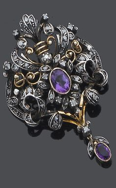 A late 19th century amethyst and diamond brooch/pendant, circa 1890 The central oval mixed-cut amethyst within a rose and table-cut diamond scrolling foliate surround with wire-work decoration, suspending an oval mixed-cut amethyst swing drop with table-cut diamond foliate surmount, later brooch fitting, length 5.8cm.