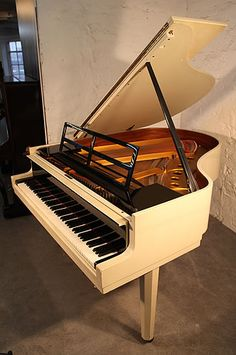 A 1966, Steinway Model M grand piano with a black and white case designed by Swedish Architect Ivar Tengbom. Piano features a minimal geometric piano lyre, square piano cheeks, octagonal, tapered facetted legs and a cut out music desk. The design emphasises the piano's planar qualities  - at Besbrode Pianos
