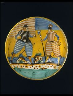 Tin-glazed earthenware dish (maiolica), painted in colours with a striding musketeer, Montelupo about 1630.
