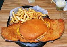 IOWA: Similar to a German schnitzel, Iowa is famous for its pork tenderloin sandwiches, which contain a breaded and fried pork cutlet. Breaded Pork Tenderloin, Pork Tenderloin Sandwich, Pork Fillet, Pork Cutlets, Pork Tenderloins, Pork Loin, Belize, List Of Sandwiches, Wraps