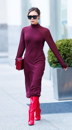 Victoria Beckham - Red has won over the hearts and closets of all fashion girls this season. Teaming two tones of the hue together makes for a high-impact look. A midi dress over slouchy boots is the ultimate fall silhouette. Turquoise earrings are cool as a contrasting finish.