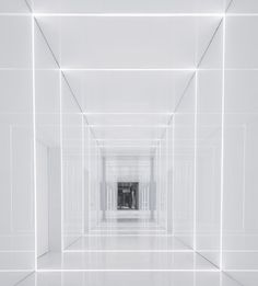 All-white coridor. Soho Fuxing Plaza by Aim Architecture.