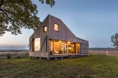 This is a 624 sq. ft. energy-efficient modern cabin. Designed by ASGK Architecture & Design for a family of three who wanted a small space to bring them closer together. There is a large slidin…