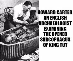 Howard Carter, an English archaeologist, examining the opened sarcophagus of King Tut