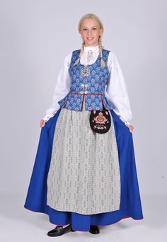 Norwegian Bunad: An example of the Trøndelag bunad in blue, worn in Trondheim and the southern part of central Norway Norwegian Clothing, Norwegian People, Norway Viking, Blue Stockings, International Clothing, White Apron, Trondheim, Folk Costume, Costumes