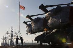ROTA, Spain (Dec. 26, 2014) Sailors raise the ship's colors as the USS Iwo Jima (LHD 7) pulls into port at Naval Station Rota, Spain, Dec. 26, 2014.