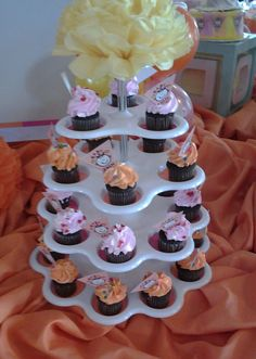 Mini-cupcakes with themed cupcake toppers.